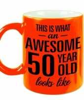 Awesome 50 year cadeau mok beker neon oranje 330 ml